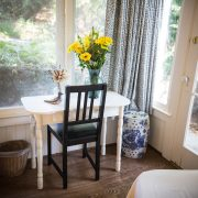 A small table and chair in the room
