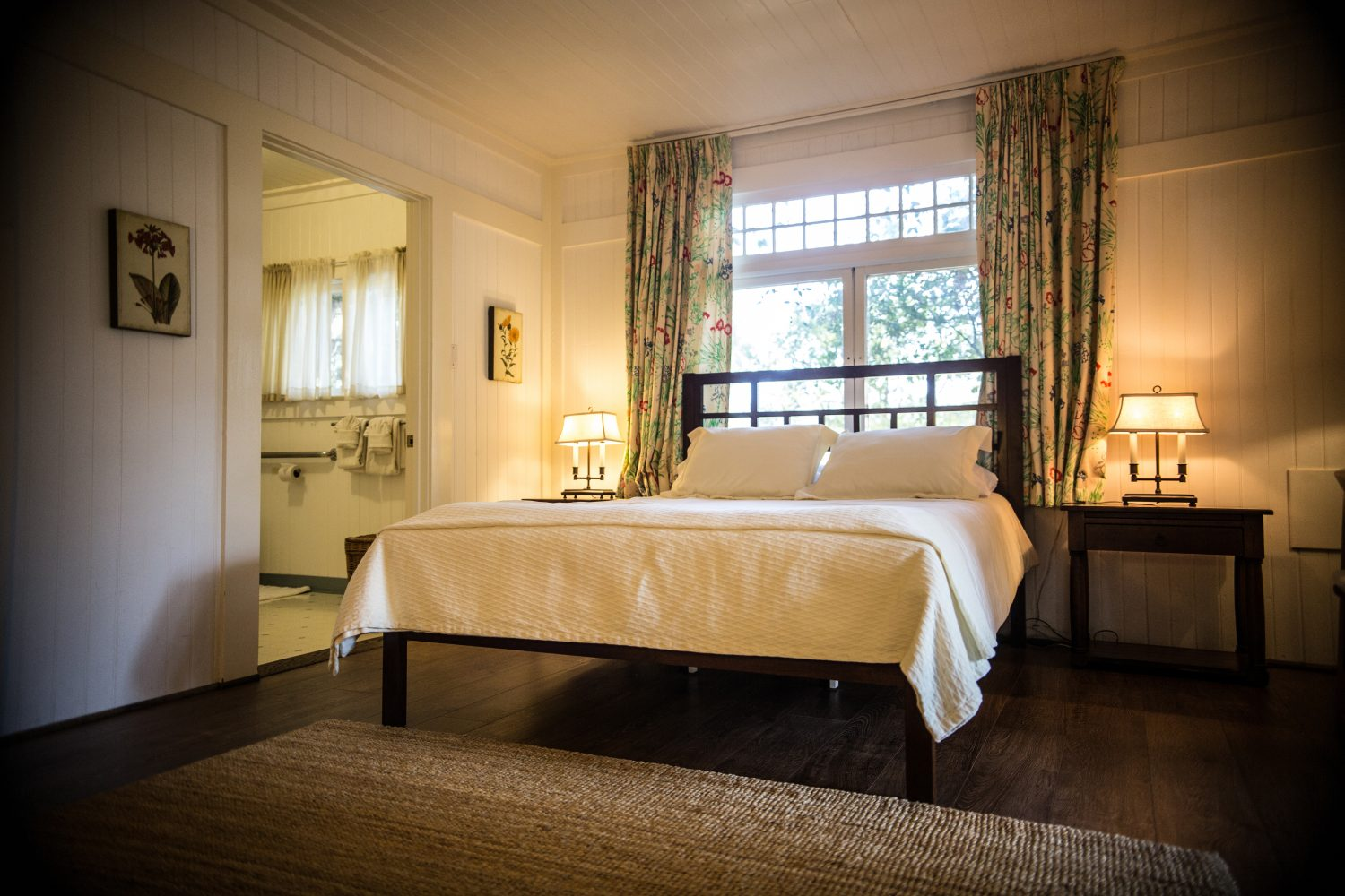 A queen size bed in besant suite